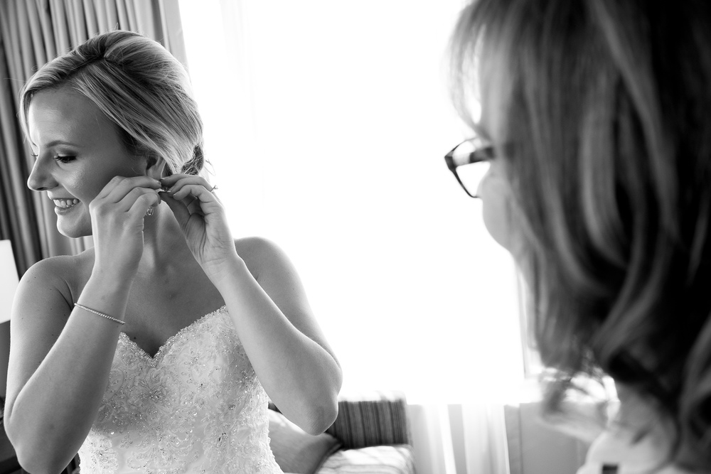 Danielle adjusts her earring as she gets ready for her wedding ceremony at the One King West Hotel in Toronto.