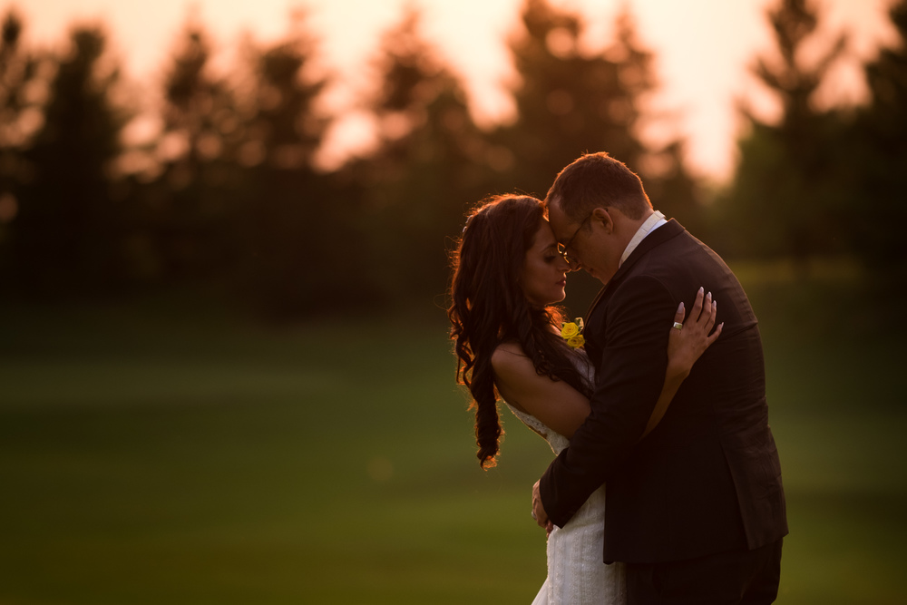 Olivia + David pose for a wedding portrait during sunset at their wedding at Copper Creek Golf Course just north of Toronto.