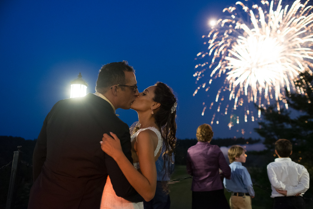 Oliva + David share a kiss during fireworks at Copper Creek in Toronto.