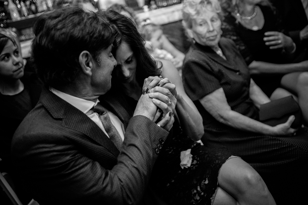 I really like this photograph from Spencer + Jonas' wedding at the Stirling Room in Toronto's Distillery District.  During the wedding ceremony, they had something called a 'ring warming' where the two wedding rings were passed around to all the guests before they said their vows.  Having shot over 300 weddings, it was nice to see something new and unique!