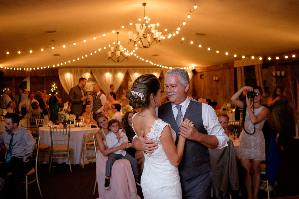 Here's another one from Rebecca + Jeff's wedding at the Hessenland Country Inn (what can I say, it was great wedding!)  I like everything about this picture... the look on Rebecca's father's face as he dances with his daughter... the guests looking on in the background... the contrast of tones between the subjects in the foreground and the warmth in the background.