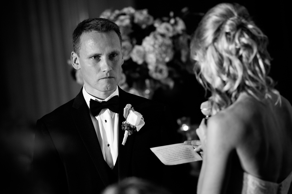 This image is from Andrea + Chris' wedding at One King West.  I love the connection they have as Chris listens to Andrea's speech.