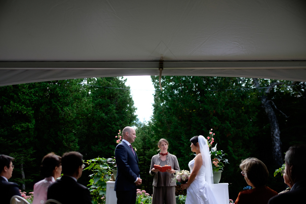 Joohee + Joel are married during their outdoor ceremony at a private residence in Tobermory.