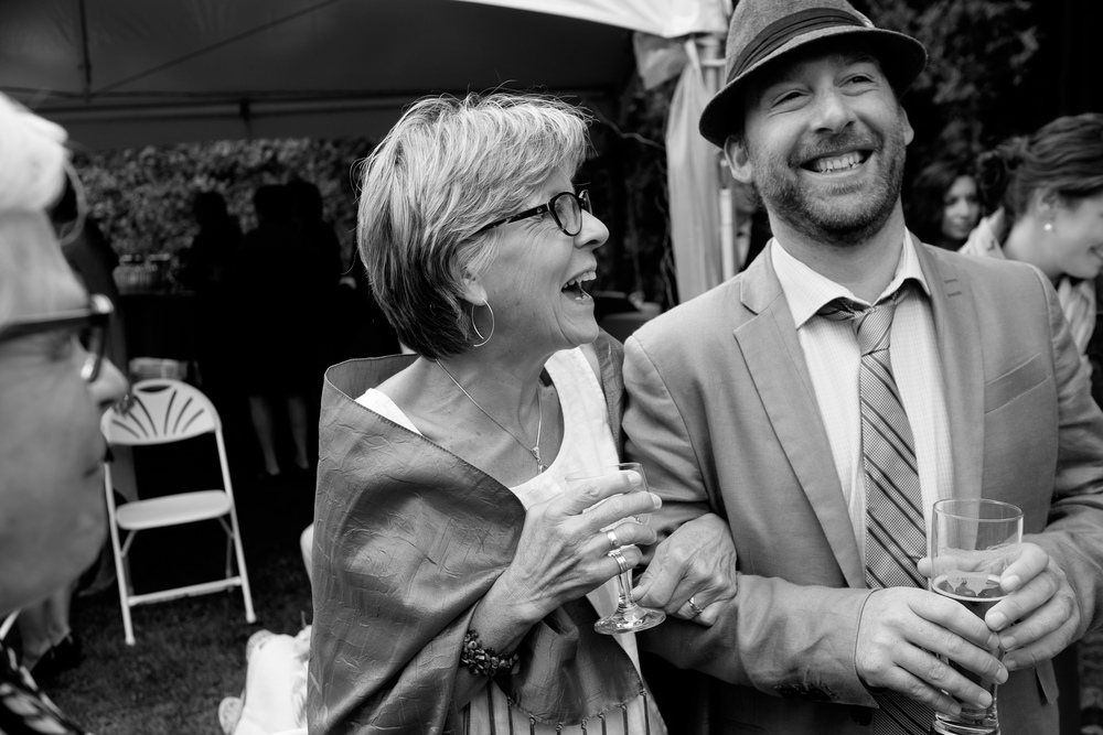 Joel's mom shares a laugh with the wedding MC during the cocktail hour at their wedding in Tobermory.
