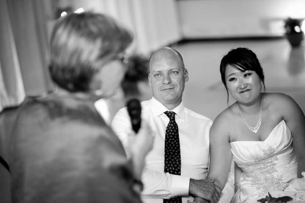 Joohee + Joel look on as Joel's mom gives her speech during the wedding reception in Tobermory.