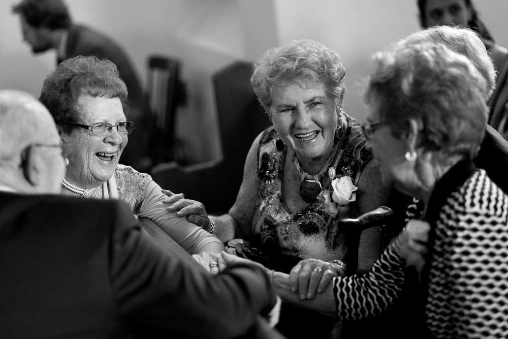 The grandparents share a laugh in the church before the ceremony.