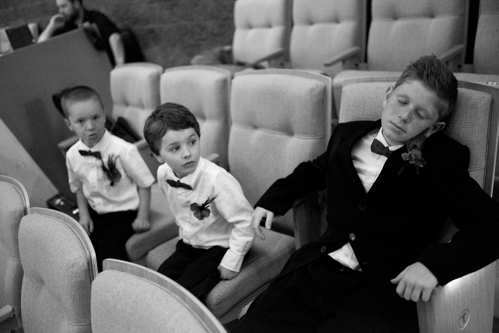 Ushers and ring bearers relax before the ceremony at Joanna + Kris' wedding at the dun field theatre in Cambridge, Ontario.