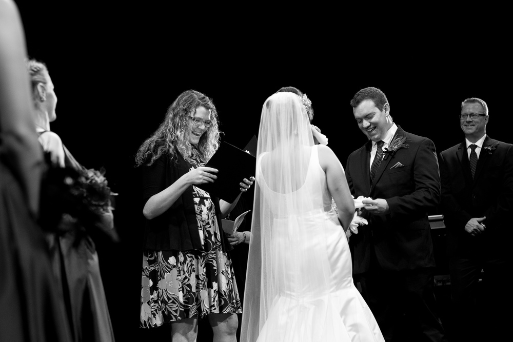 Joanna + Kris' exchange wedding vows up on the stage during their ceremony at the dunfield theatre in Cambridge, Ontario.