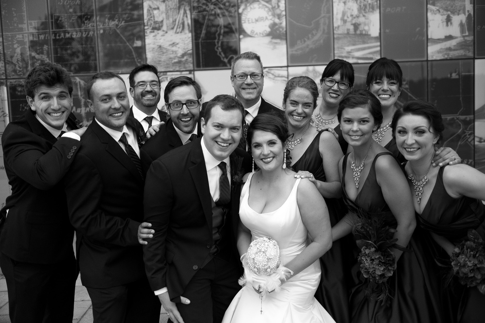 Joanna + Kris pose with their wedding party for a portrait during the reception at the Waterloo Region Museum.
