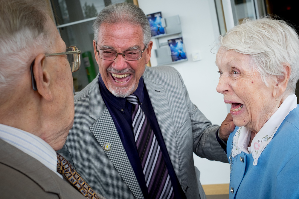 Relatives share a laugh together after the wedding ceremony at dunfield theatre in Cambridge.