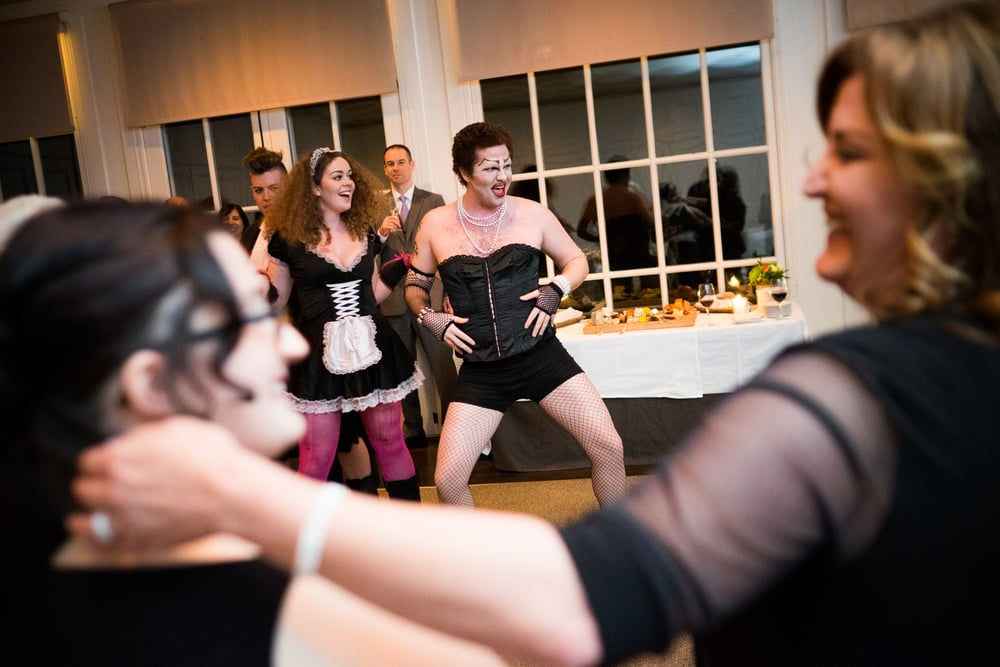 Renee + Senem enjoy a performance by the cast of Rocky Horror Picture Show during their wedding reception at Langdon Hall in Cambridge, Ontario.