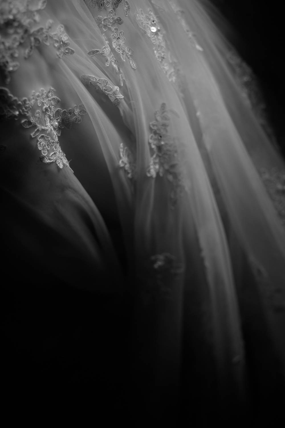 A black and white detail photograph of Jennifer's wedding dress from her Toronto wedding.