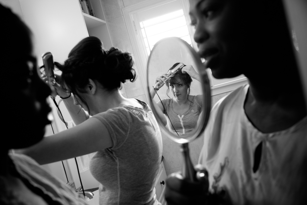 Jennifer's bridesmaids get ready at her parents house before their Toronto wedding.
