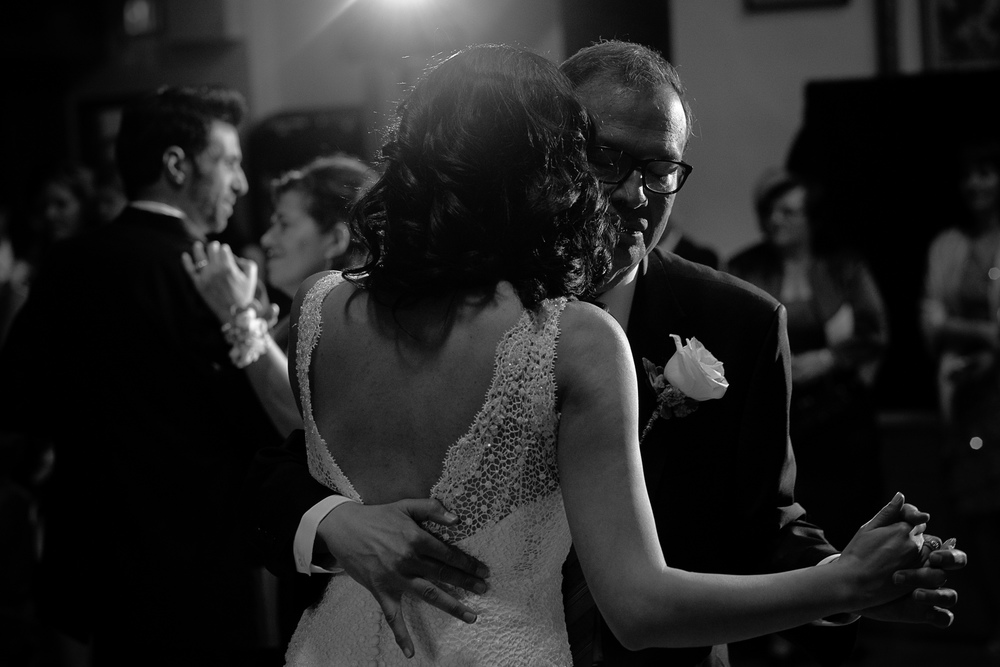 Maria dances with her father during the Toronto wedding reception while Theo dances with his mother in the background.
