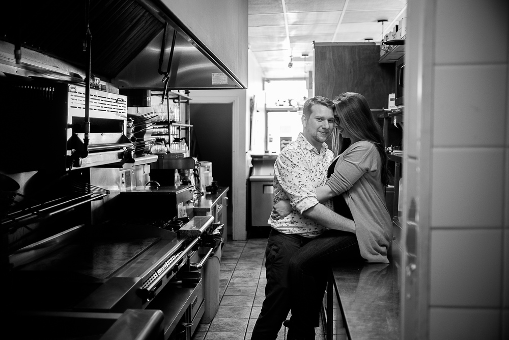 Haley + Stephen pose for a quick engagement portrait inside the kitchen of their Toronto restaurant.