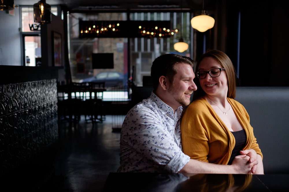 A restaurant engagement photograph from Haley + Stephen's downtown Toronto engagement session.