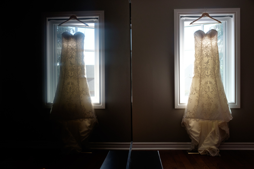 A  detail photograph of Laura's wedding dress hanging in her Oakville home.