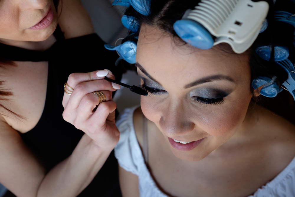 Laura has her make up applied while getting ready for her wedding at the Paletta Mansion in Mississauga.