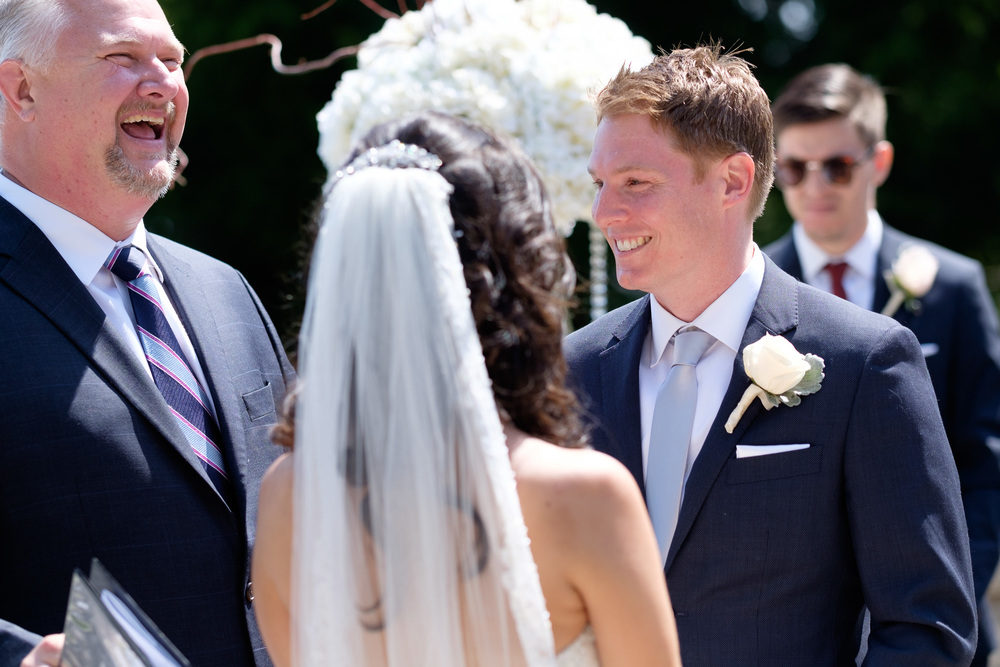 A photograph from Laura + Chris outdoor wedding ceremony at the Paletta Mansion in Mississauga.
