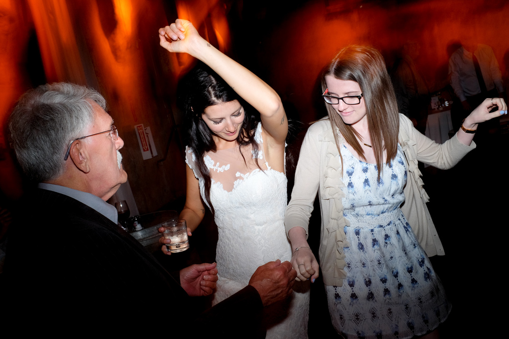 Guests dance and party during the wedding reception at the Fermenting Cellar.