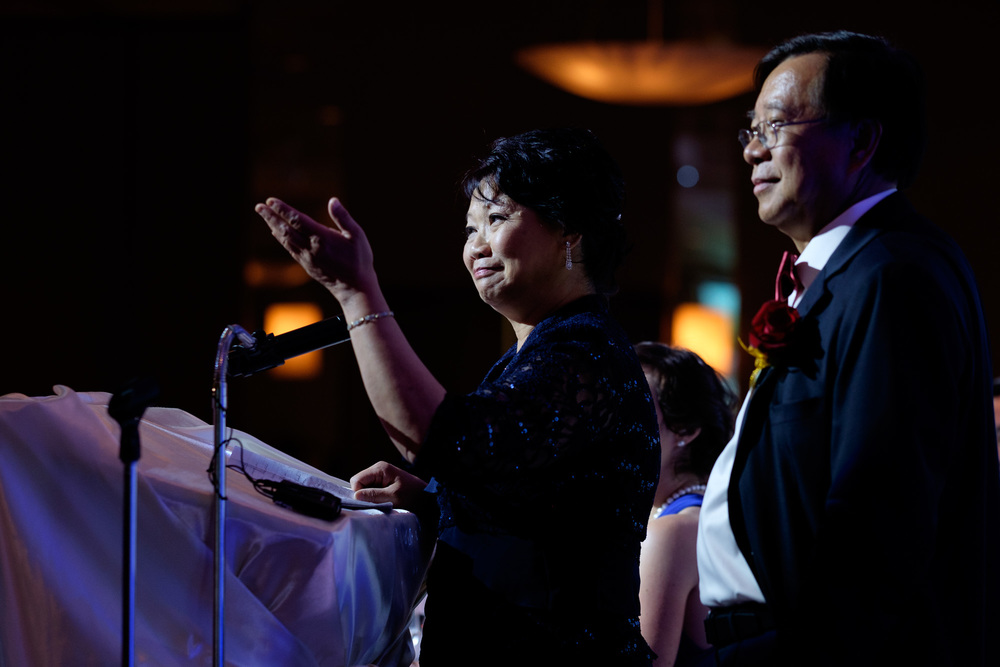 Jonathan's parents toast the newly married couple during their wedding reception in Toronto at the Columbus Centre.