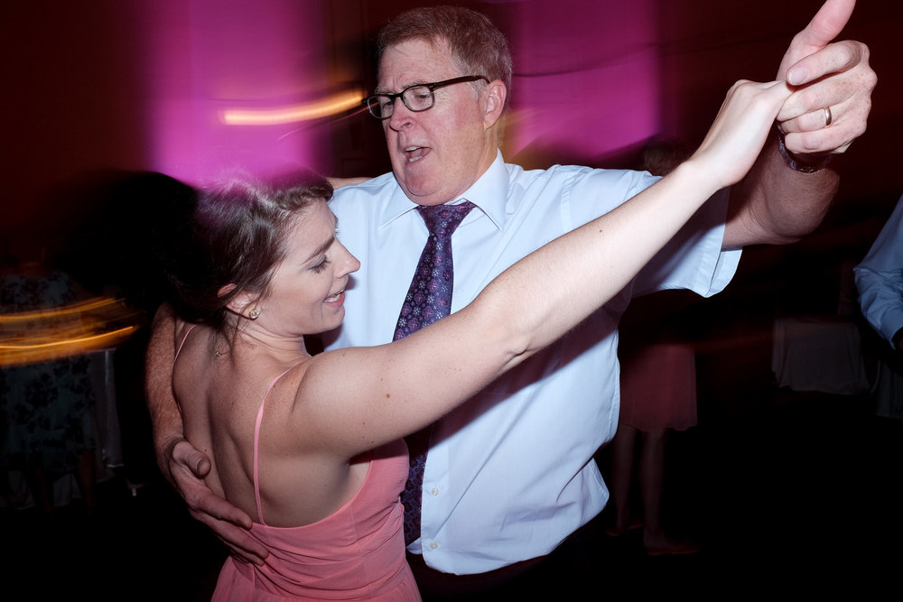 A past bride and her father dance at Melanie & David's wedding reception in Toronto.