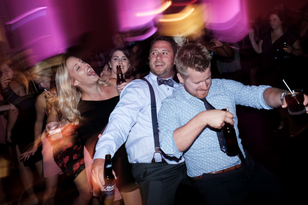 Guests enjoy the party and the dance floor at Melanie & David's wedding reception at the Toscana in Toronto.