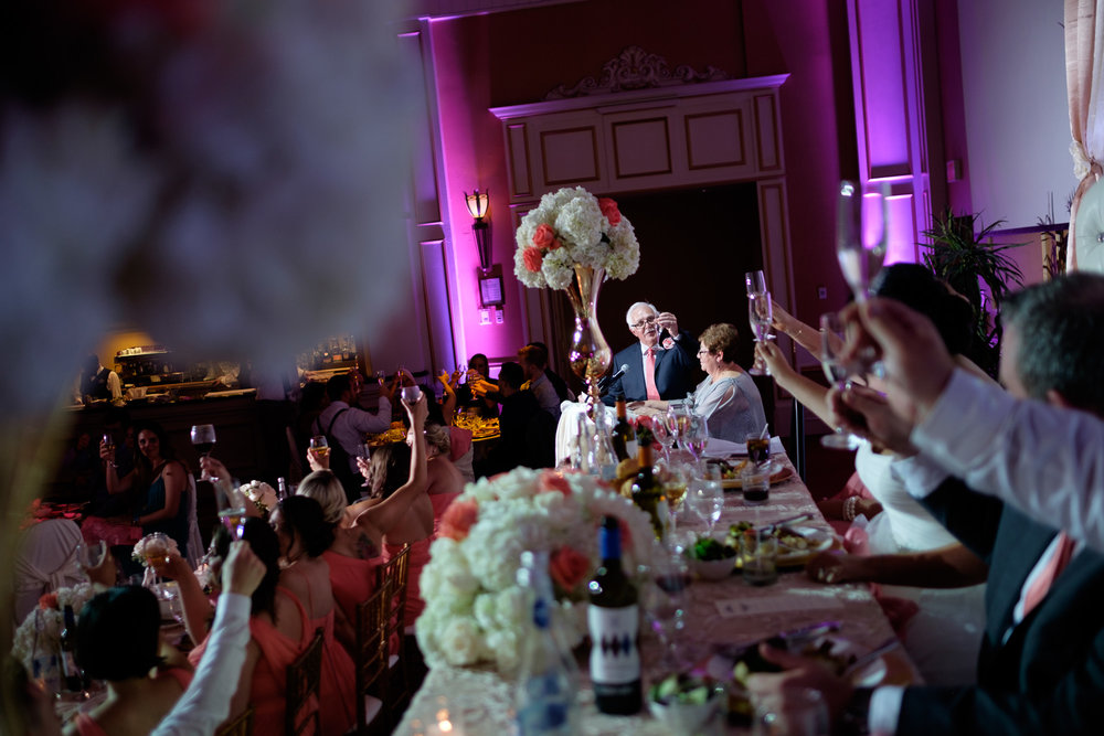The bride's parents offer a toast to the newlywed couple during their wedding reception at the Toscana hall in Toronto.