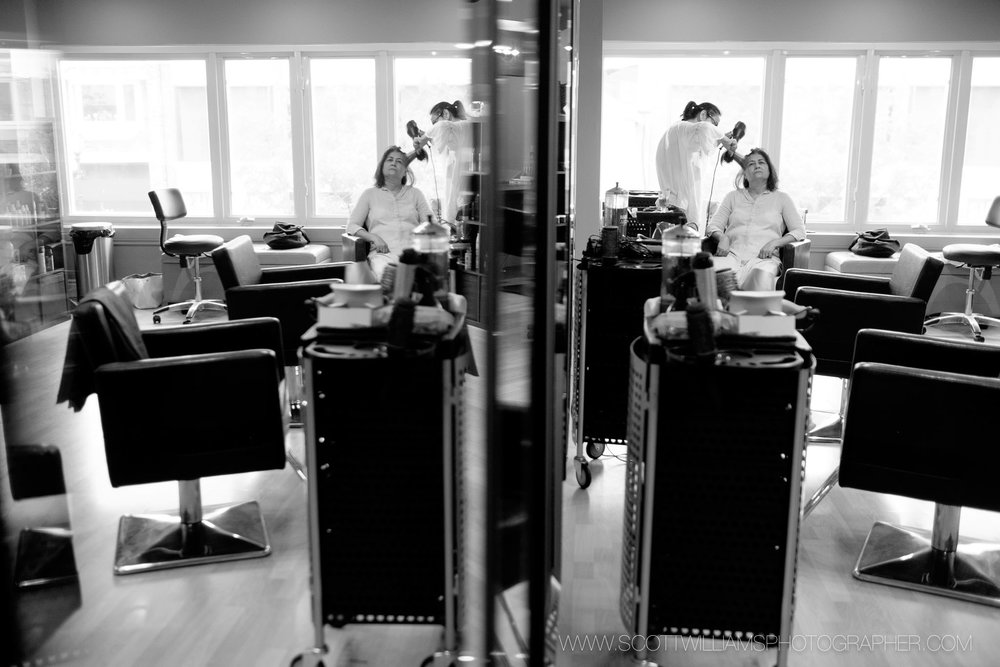 The bride gets her hair and make up done at the salon before her wedding at the Ancaster Mill in Ancaster, Ontario.