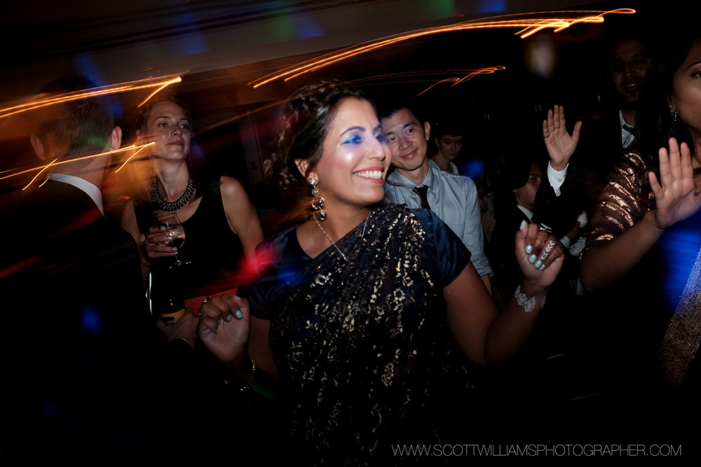 Wedding guests party and dance the night away during the wedding reception at the Ancaster Mill in Ancaster, Ontario.