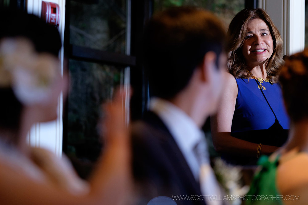 The mother of the groom gives a heartfelt speech during the wedding reception at the ancaster mill in Ancaster, Ontario.