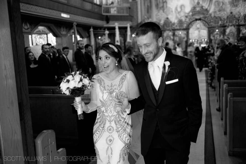 Christina and Tim are all smiles after walking down the aisle as husband and wife after their Ukrainian wedding ceremony in Toronto.
