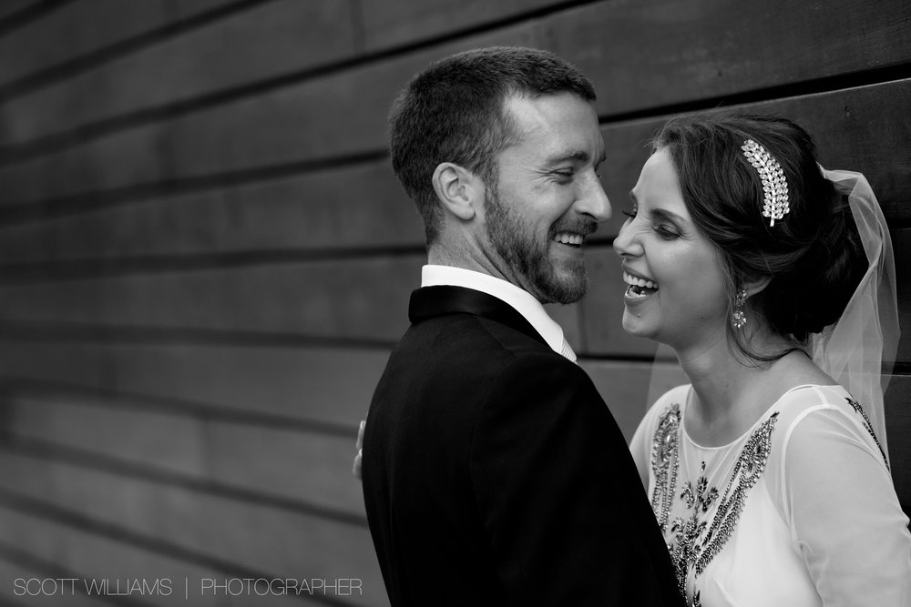 Christina & Tim share a laugh while posing for wedding portraits during their wedding at Malaparte in Toronto.