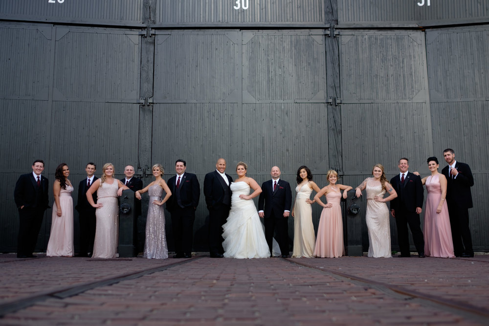A photograph of the wedding party from Savannah + Bernie's wedding at the SteamWhistle Brewery in downtown Toronto.