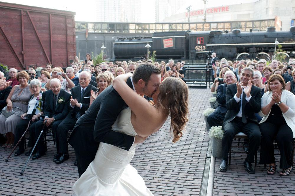 steamwhistle-wedding-first-kiss