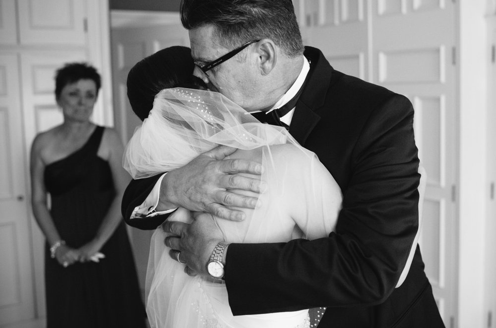 Grayson-Hall-Wedding-bride-hugged-by-father