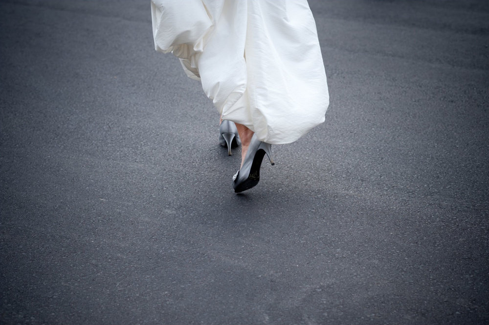 A bride runs across a busy street during her wedding day in Kitchener-Waterloo.