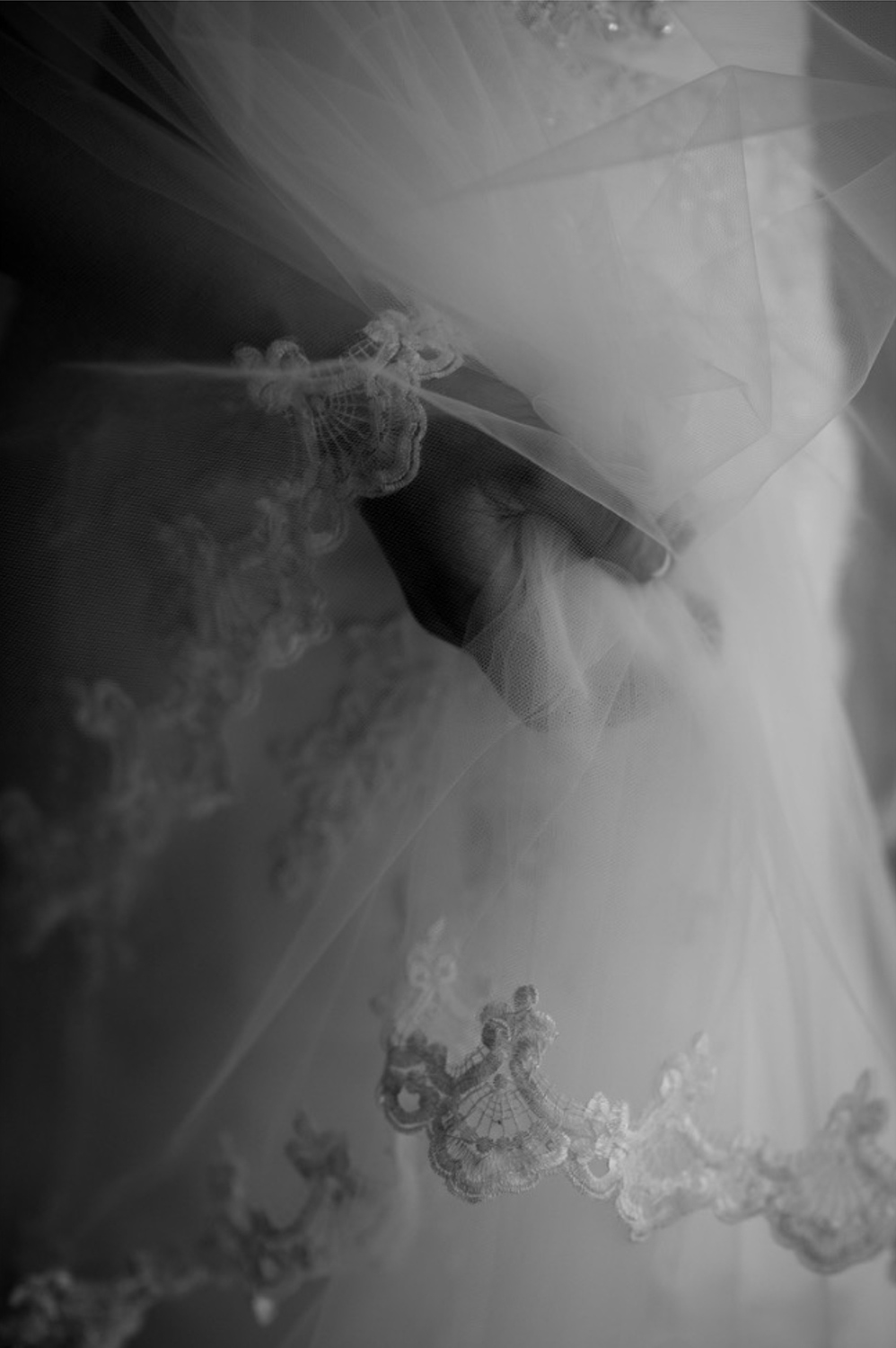 A bride holds onto her veil before the wedding ceremony.