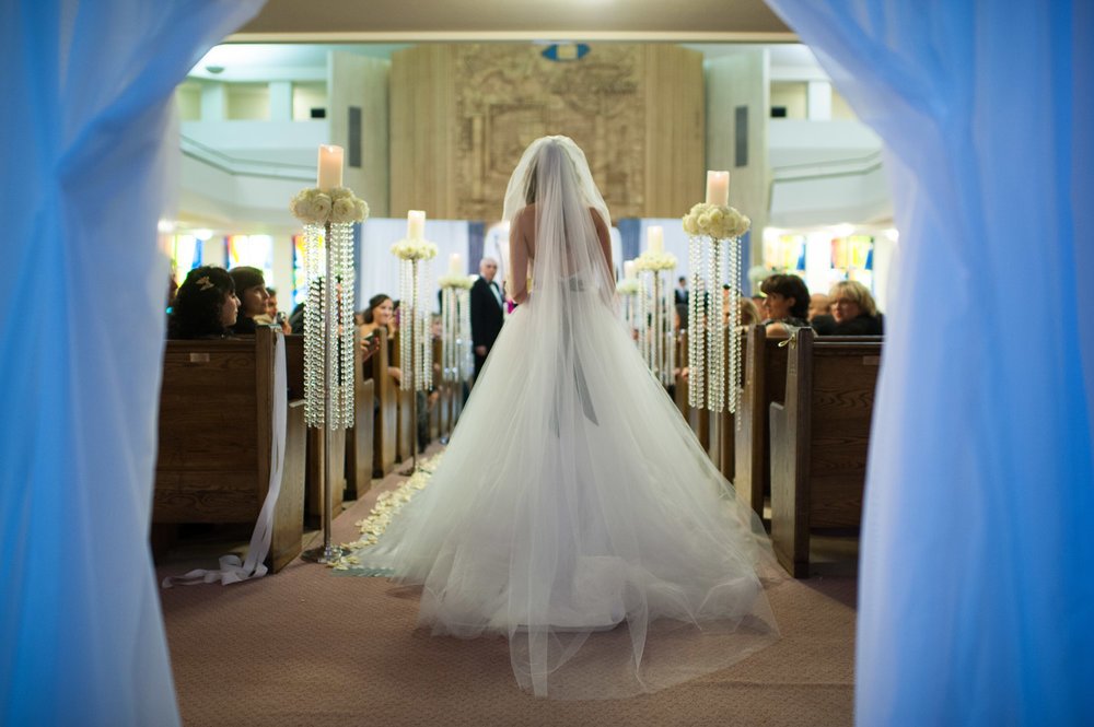 A bride walks down the aisle during her Jewish wedding ceremony in Toronto.