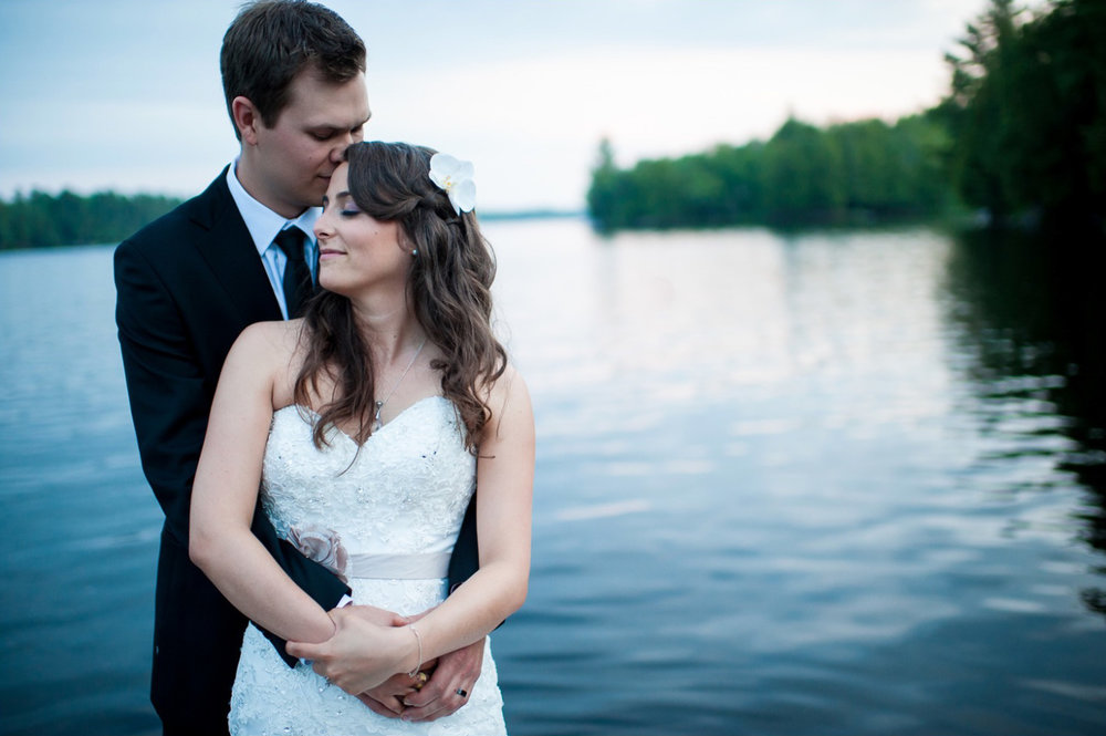Cassandra and Jesse take a moment during their wedding reception for a nice sunset portrait on dock during their Muskoka wedding at Ridge at Manitou.