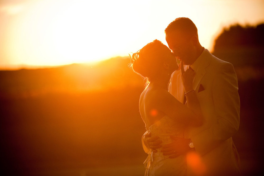 A stunning wedding portrait of Michelle + Chris taken at sunset during their wedding reception in Brampton.