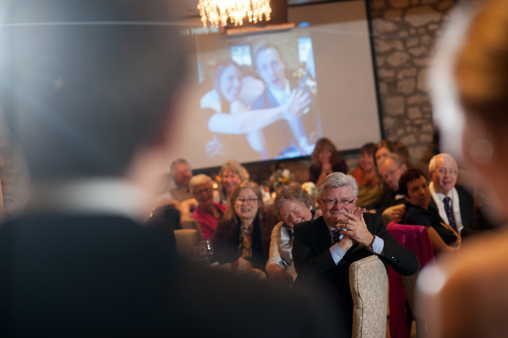 Dad enjoying the moment as the bride and groom give their speech during their wedding reception at the Cambridge Mill.