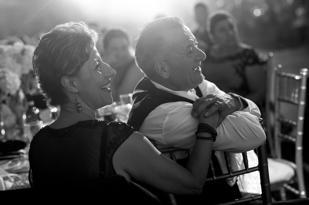 Action. Reaction.  This is one of the principles I've always used when photographing weddings.  As Bobby + Nicole were giving their speech during the reception in Toronto I made to sure to get some great pictures of the two of them and then looked to the guests to capture some reactions.  That's when I found this great moment of the grooms parents adoring faces and smiles.
