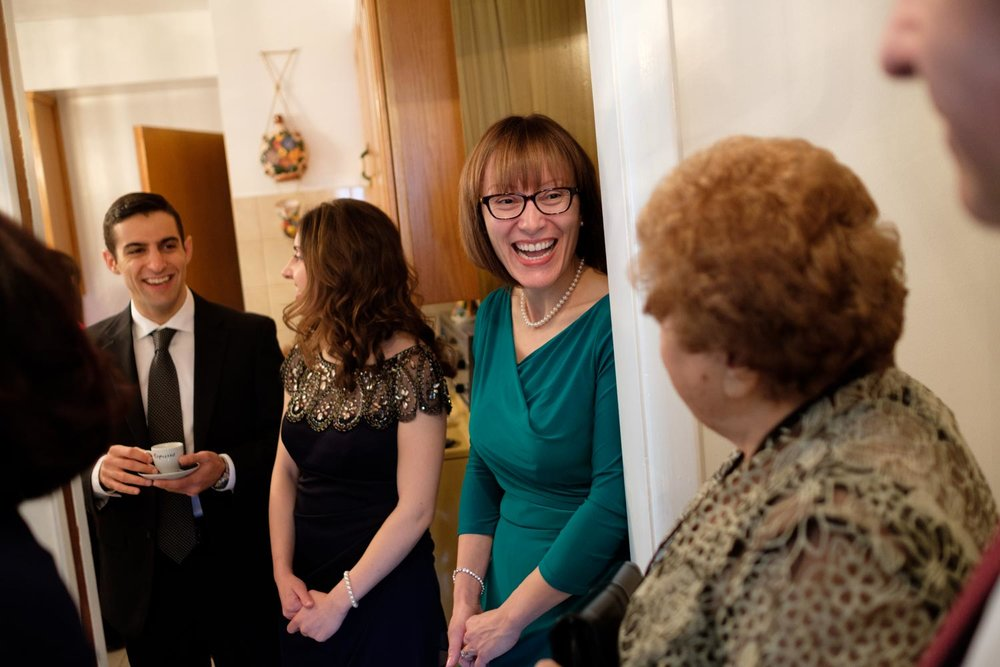 Wedding guests sharing a laugh while getting ready for the ceremony.