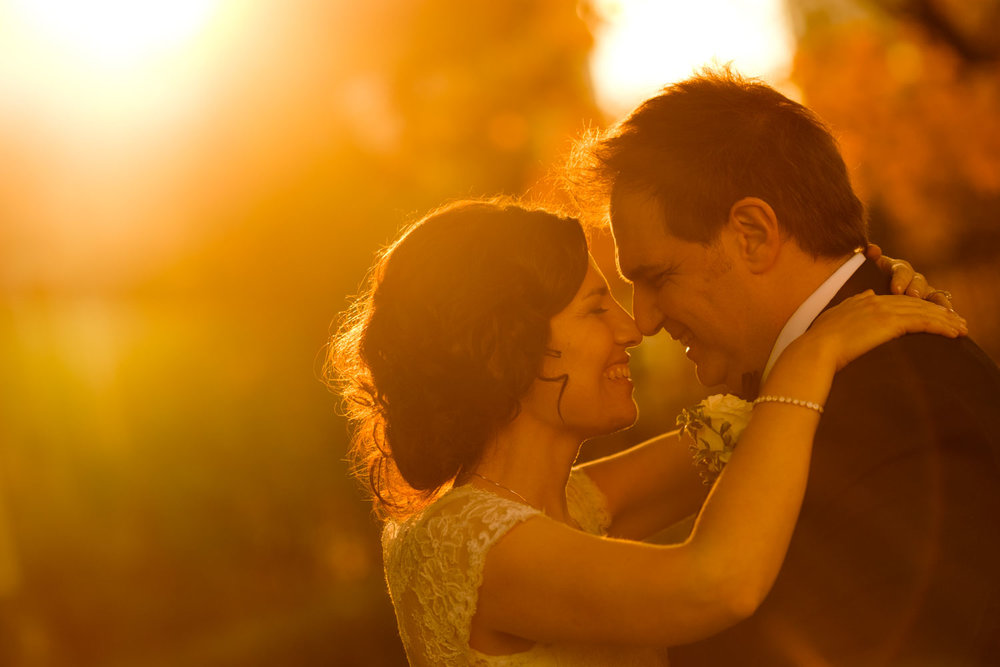 A sunset wedding portrait at Graydon Hall in Toronto.