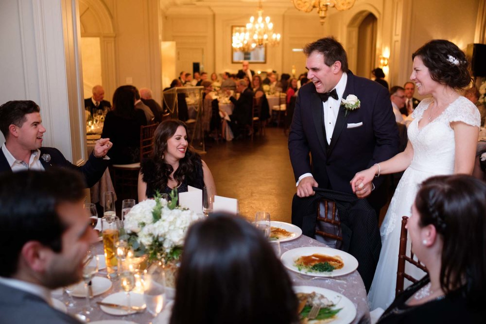 Newlywed couple greets their guests during the reception at their wedding at Graydon Hall in Toronto.