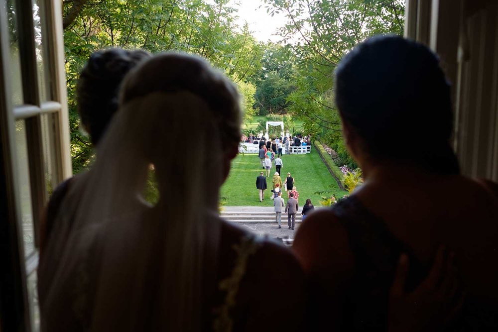 a wedding image from a sam sex wedding at Graydon Hall in Toronto.