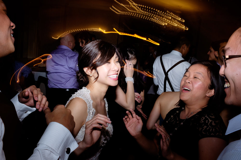 It's not much of a secret that my favourite part of the wedding is the party at the end of the night... I'm one of the few wedding photographers in Toronto that cover the entire day from start to finish.  Haidee is having an amazing time with her friends on the dance floor during their wedding reception at Estates of SunnyBrook in Toronto.