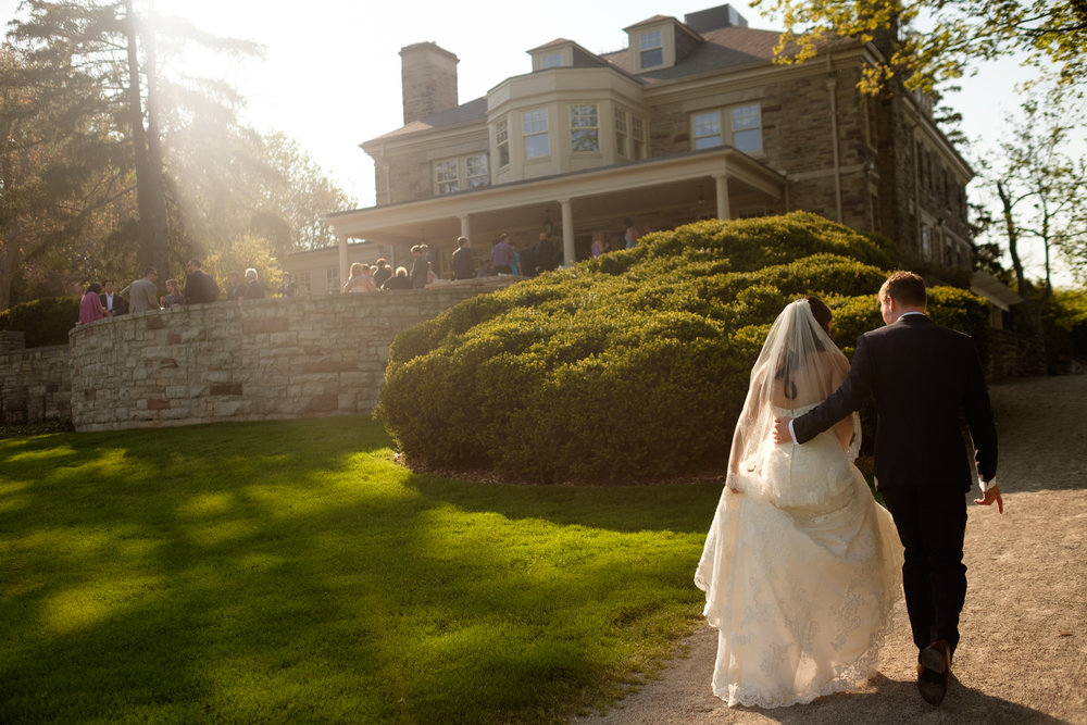 I love this small, intimate moment as Laura + Chris walk back to their wedding at Paletta Mansion after we did some wedding portraits down by the lake.