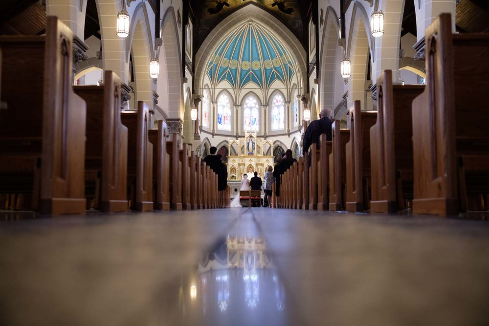 I'm always looking for a different angle, especially during wedding ceremonies.   Sometimes you have to get right down on the floor for that different angle.   This one is from Jenny + John's Catholic wedding in Toronto.